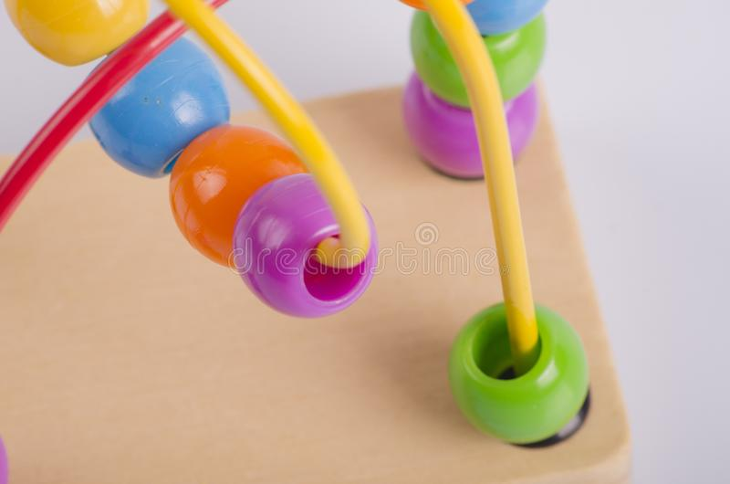closeup image of beads roller coster ball toy on white background stock images