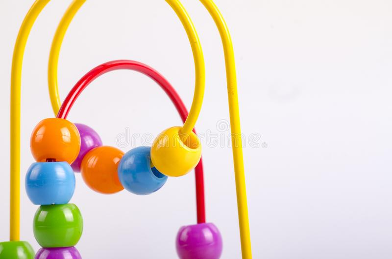 closeup image of beads roller coster ball toy on white background royalty free stock photos