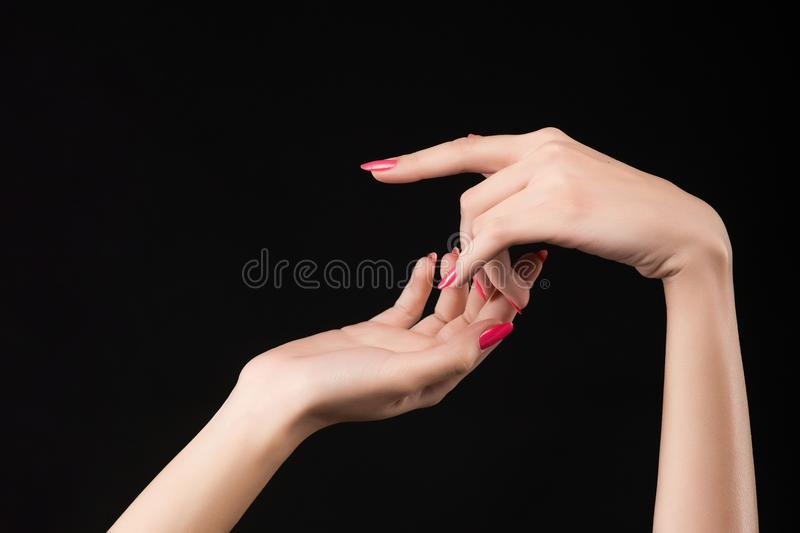 Beautiful woman hands with pink manicure on the nails isolated o royalty free stock images
