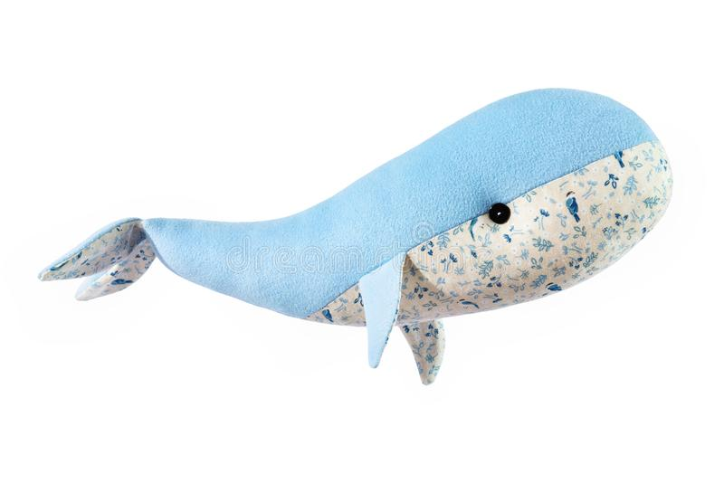 Closeup image of blue toy whale pillow with ornament isolated. At white background stock image