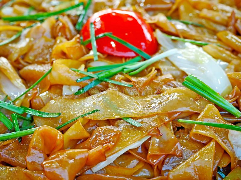Street Food - Fried Noodles with Soy Sauce stock photography