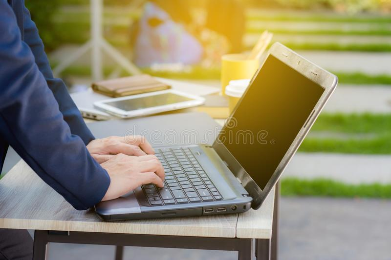 Closeup image of a hands working and typing on laptop keyboard. stock photo