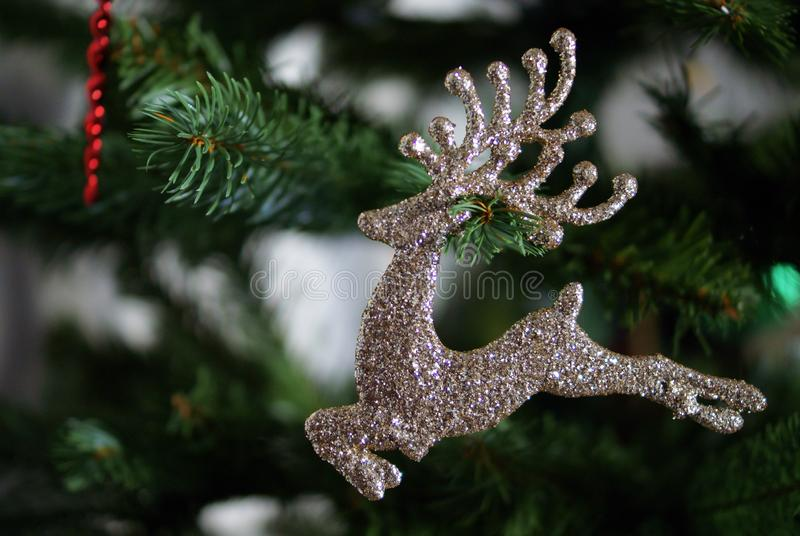 Christmas tree toys and decorations. Golden reindeer. royalty free stock photo