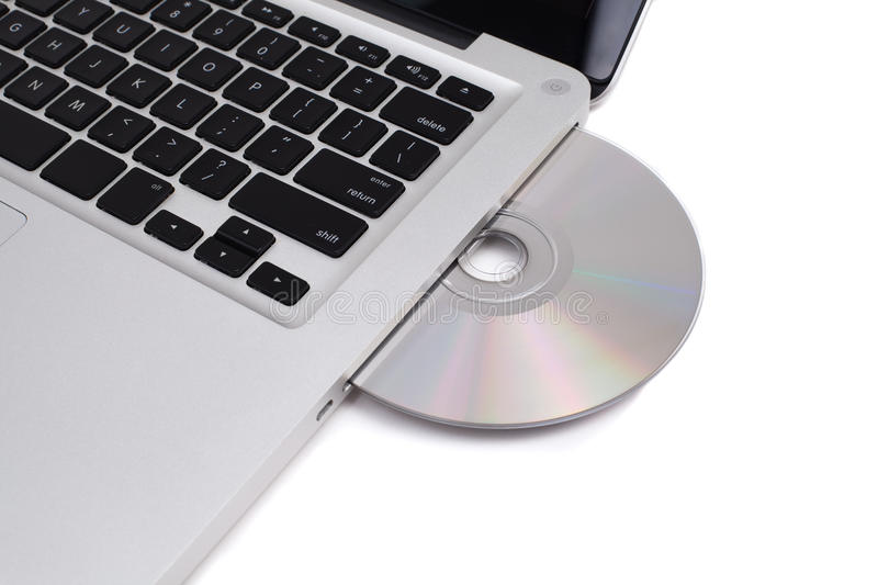 Closeup image from a laptop and a CDRom. / DVDRom reader royalty free stock photography