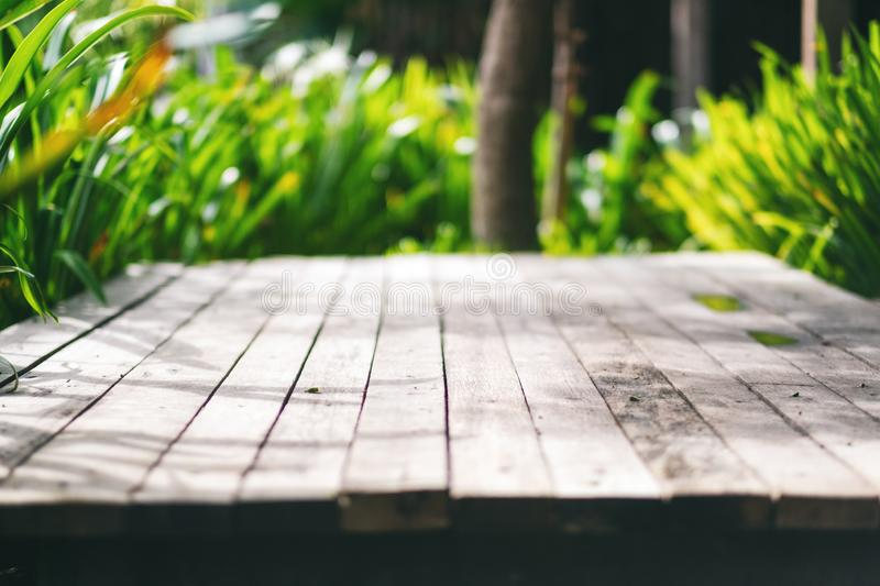 An old wooden terrace in the outdoors background and texture. Closeup image of an old wooden terrace in the outdoors background and texture royalty free stock photo