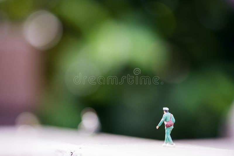 A small soldier model figure on wooden floor with blur green nature background royalty free stock photos