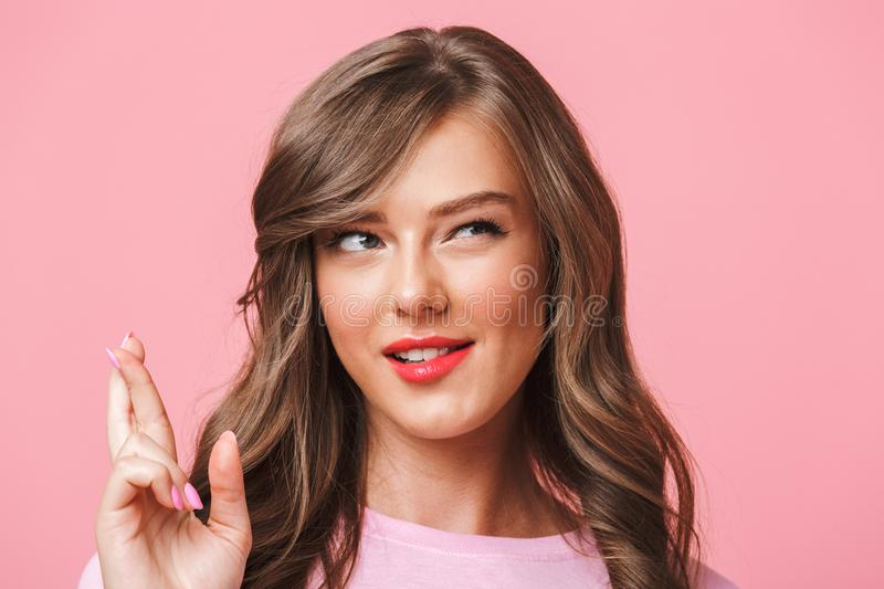 Closeup image of superstitious brunette woman in basic clothing stock images