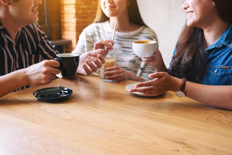 People enjoyed talking and drinking coffee together in cafe royalty free stock photos