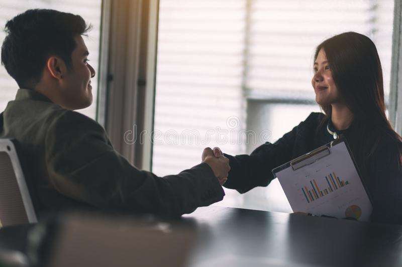 Two businesspeople shaking hands in a meeting. Closeup image of two businesspeople shaking hands in a meeting royalty free stock images