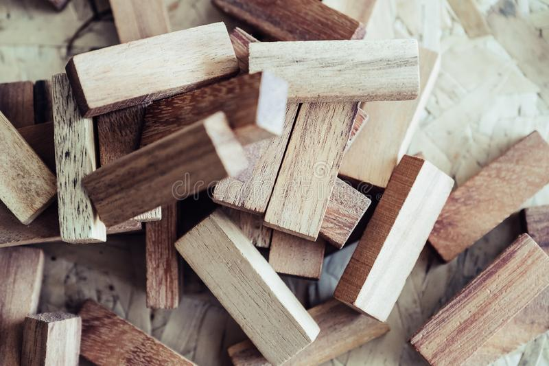 Wooden blocks of Jenga or Tumble tower game. Closeup image of wooden blocks of Jenga or Tumble tower game stock photography