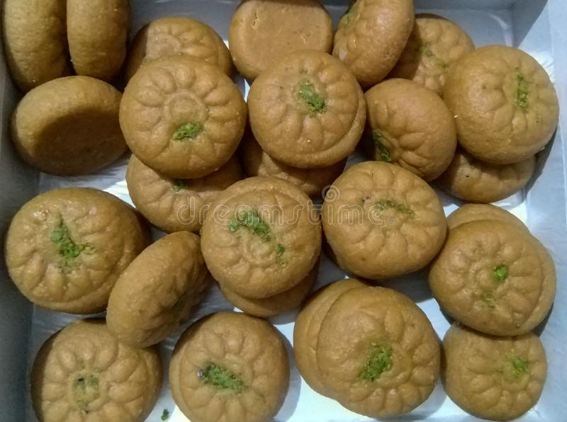 Closeup of Indian sweets garnishing with pistachios paste, festive season desserts, food photography stock photography