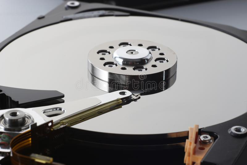 Closeup of the inside of harddrives, dismantling hdd. Computer repair hard drive, macro foto royalty free stock images