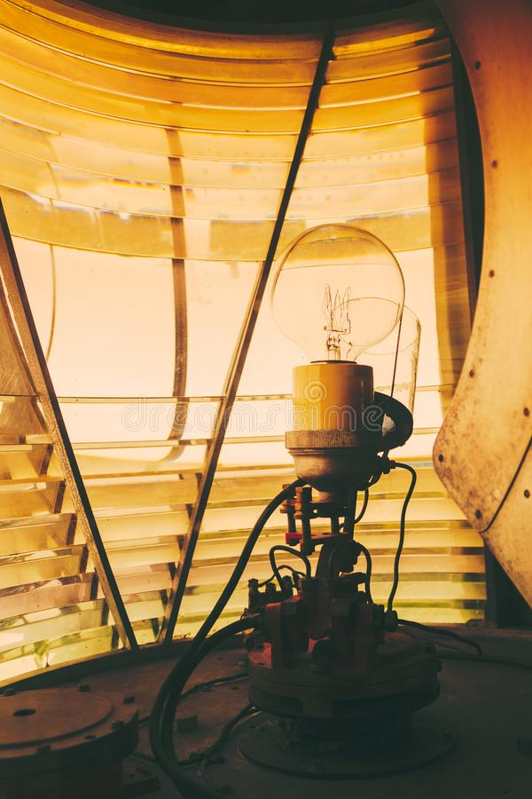 Inside of a lighthouse showing the light bulb interior. Closeup inside of old lighthouse showing the light bulb interior royalty free stock photo