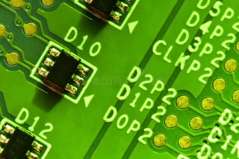 Closeup of integrated electronic circuit in a bright green light. Selective focus, closeup of integrated electronic circuit in a bright green light royalty free stock image