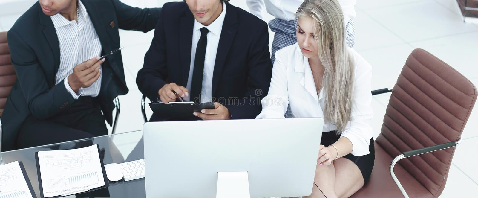 Closeup. international business team discussing business issues. stock photo