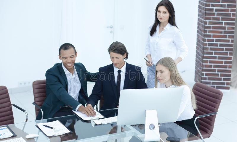 Closeup.international business team discussing business issues. photo with place for text royalty free stock photos
