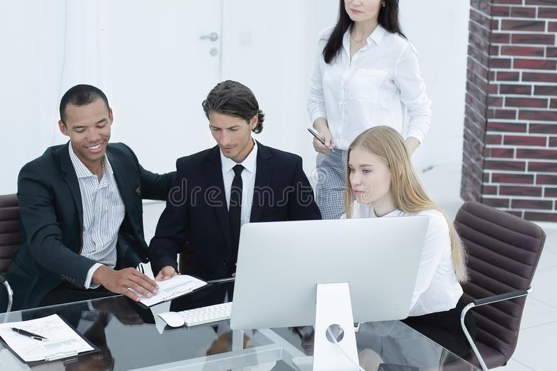 Closeup.international business team discussing business issues. with place for text royalty free stock image
