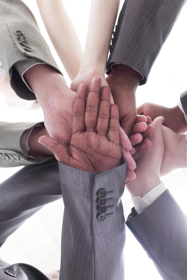 Closeup.international business team showing their unity. royalty free stock photography