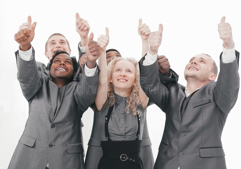 Closeup.international business team showing thumbs up and looking at copy space stock photo