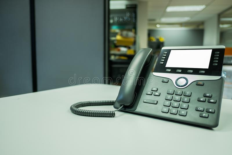 Closeup ip phone deveice on office desk. Closeup ip phone deveices put on office desk in the room royalty free stock image