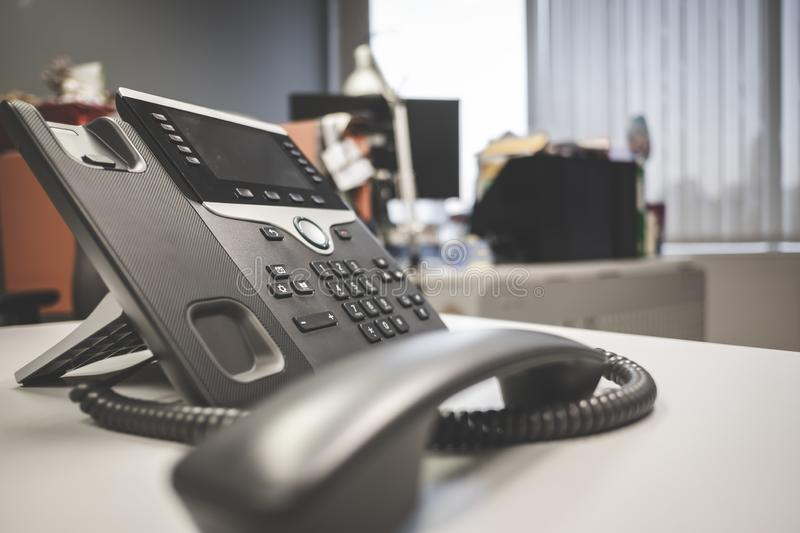 Closeup ip phone deveice on office desk. Closeup ip phone deveices put on office desk in the room royalty free stock images