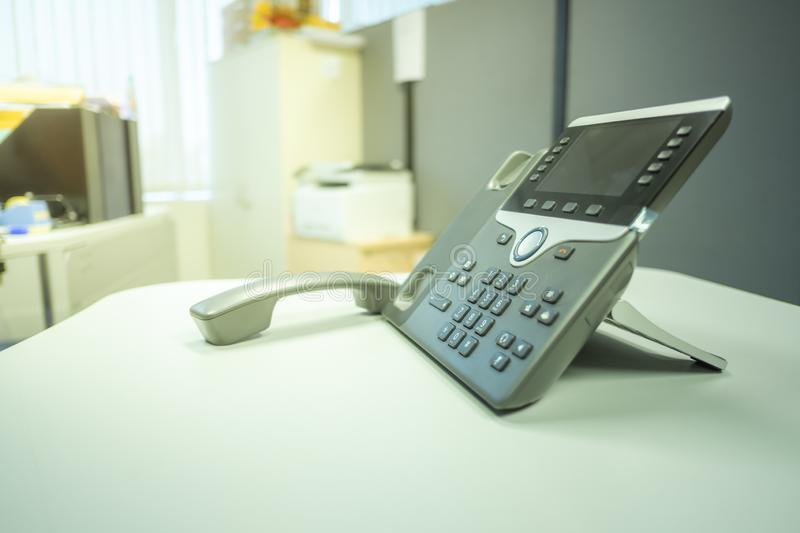 Closeup ip phone deveice on office desk. Closeup ip phone deveices put on office desk in the room , Concept sunsets royalty free stock image