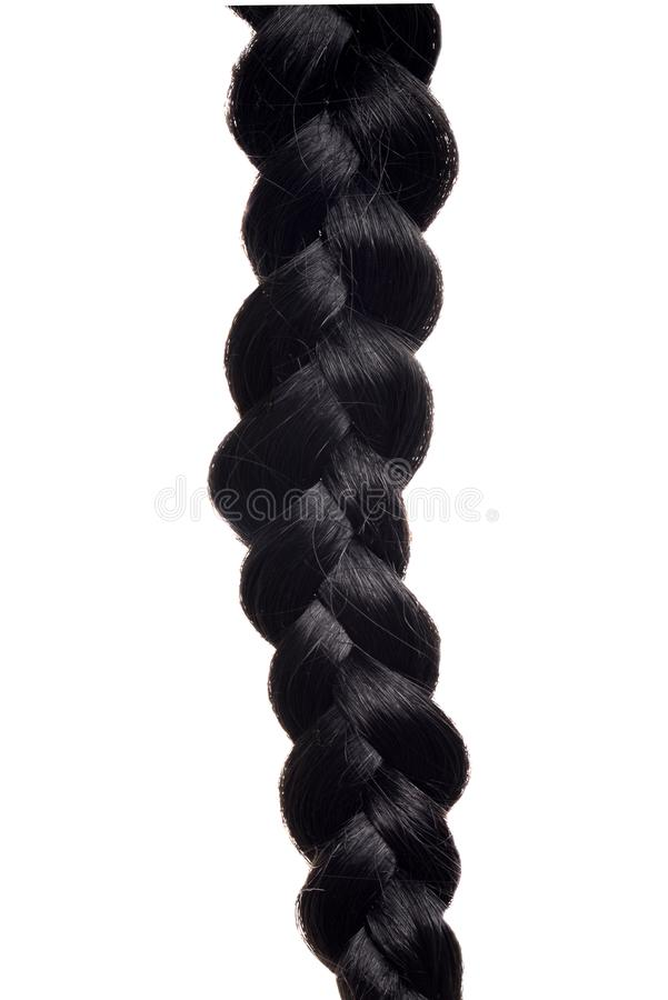 Closeup isolated black hair braid. On a white background stock image