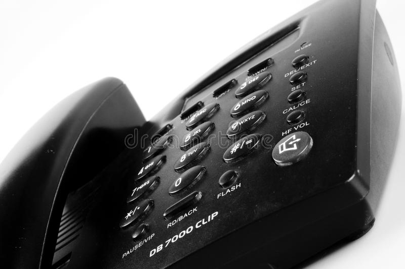 Closeup of an Isolated black landline phone royalty free stock photos