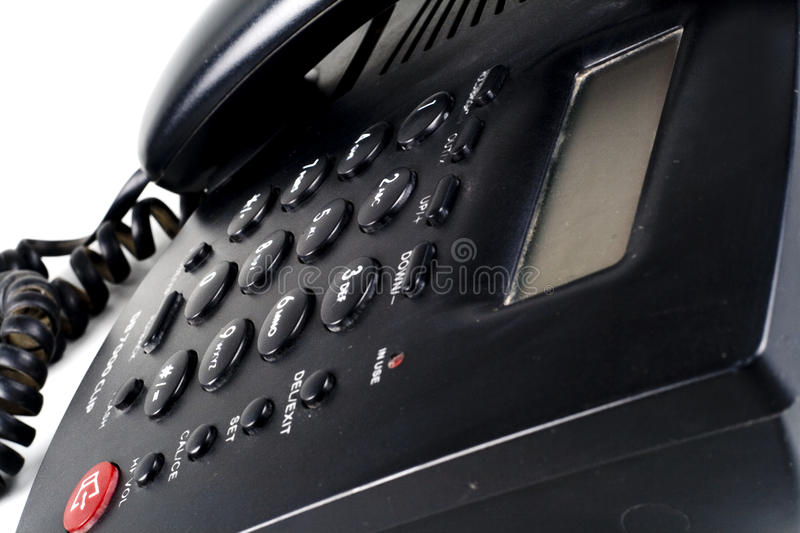 Closeup of an Isolated black landline phone royalty free stock image