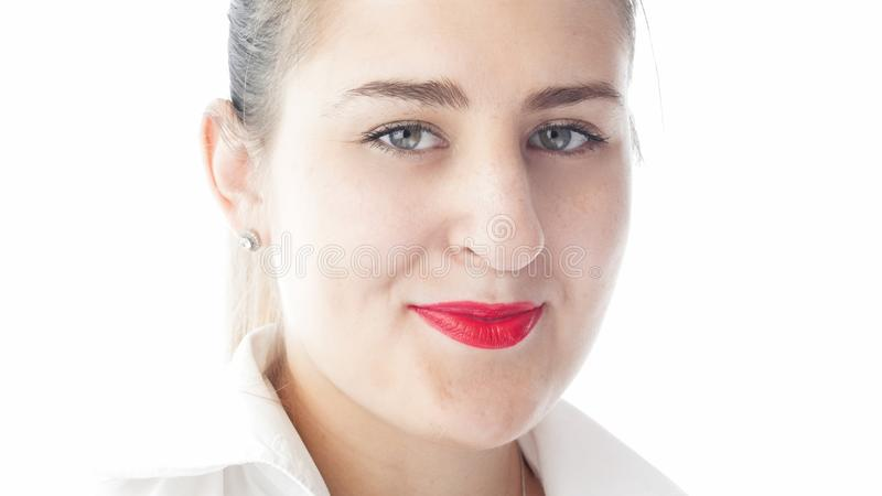 Closeup isolated portrait of beautiful young woman with red lipstick and white shirt stock image