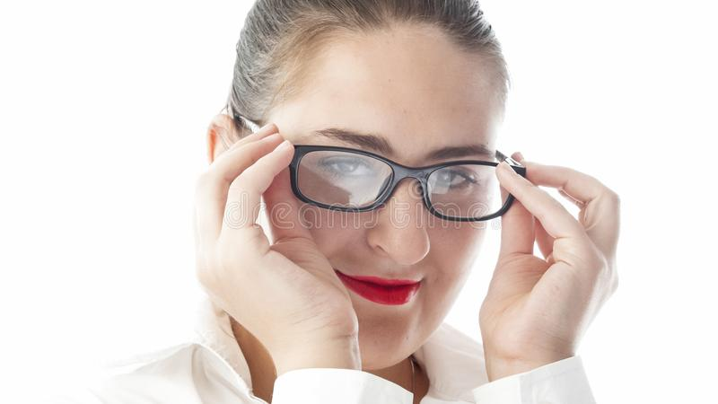 Closeup isolated portrait of young woman in eyglasses and red lipstick looking in camera stock photos