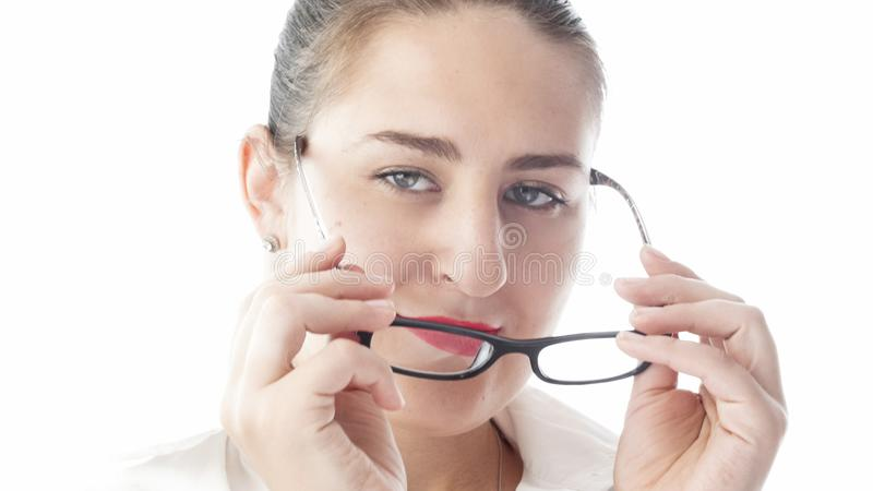 Closeup isolated portrait of young woman in white shirt wearing eyeglasses royalty free stock photography