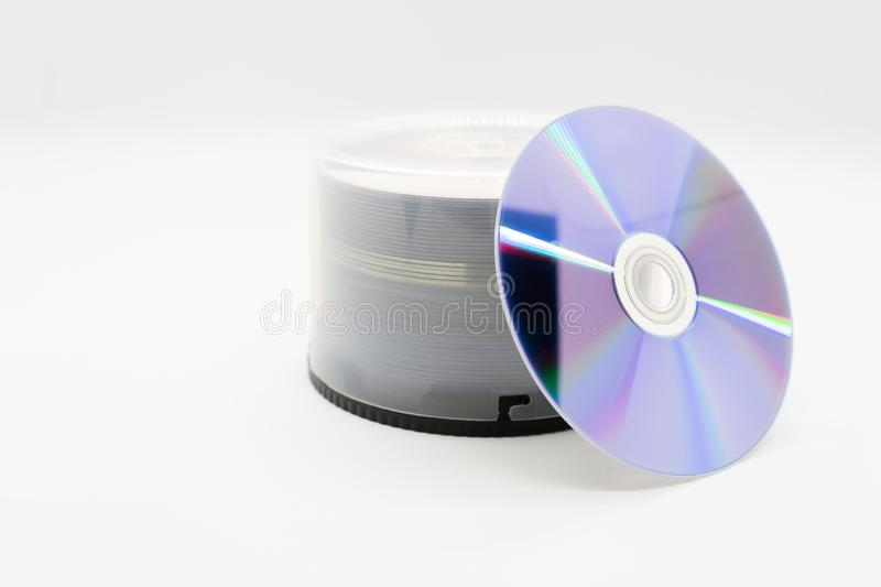 Closeup isolated on white background of a stack compact disc CD and DVD. Pile of cd& x27;s, dvd& x27;s discs stock images