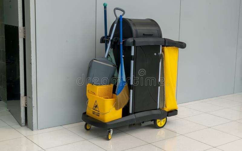 Closeup of janitorial. yellow mop bucket and set of cleaning equipment at the airport stock image