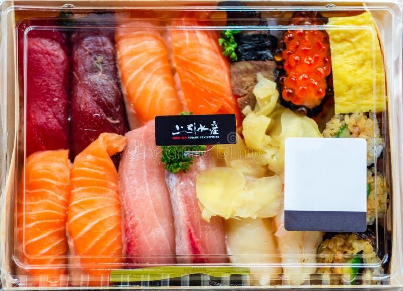 Closeup Japanese style fresh Sushi and Sashimi in a box set at Addiction Aquatic Development or Taipei Fish Market. royalty free stock photo