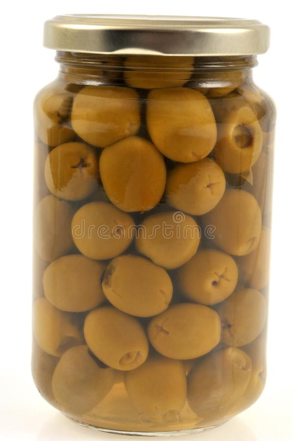 Jar of green olives stock photos