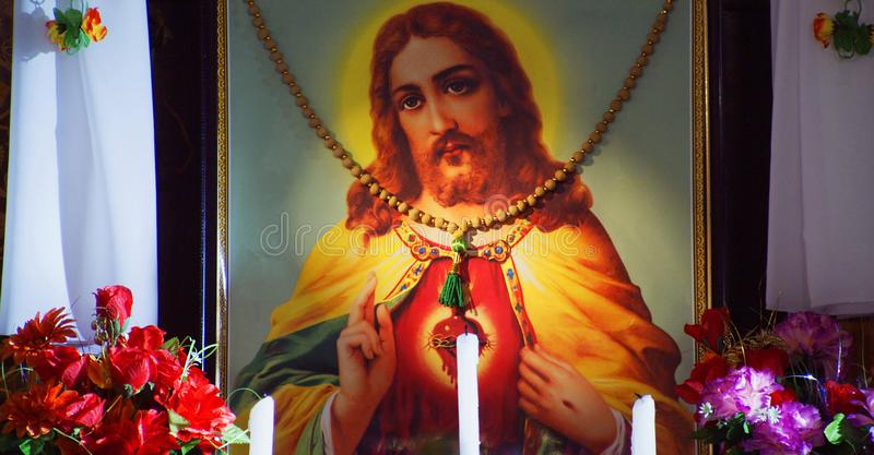 Closeup Jesus photo frame with candle decorated stock image