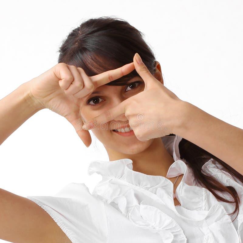 closeup jeune femme d'affaires faisant le cadre de main images stock