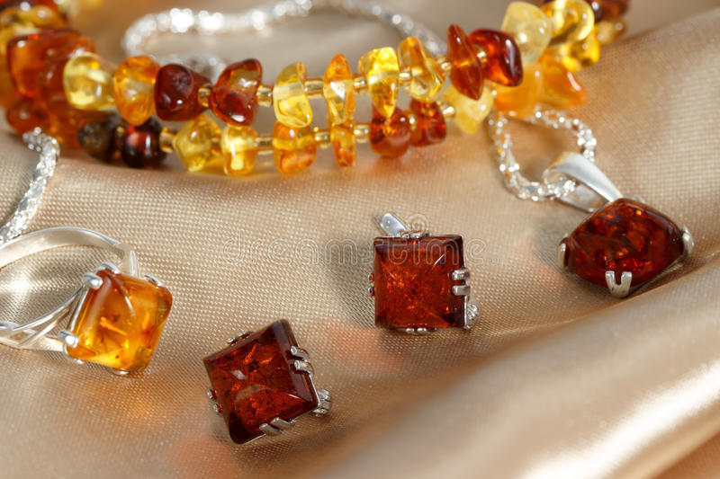 Closeup jewelry with authentic natural baltic amber stock images