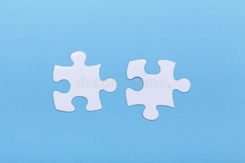 Closeup of jigsaw puzzle on blue background Missing jigsaw puzzle piece, business concept for completing the piece stock photo