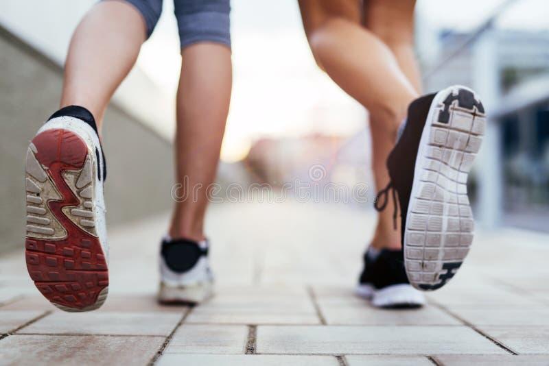 Closeup of joggers` feet stock photography