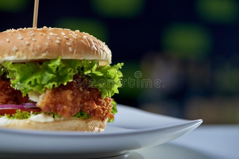 Closeup of juicy burger with fried chicken stock photo
