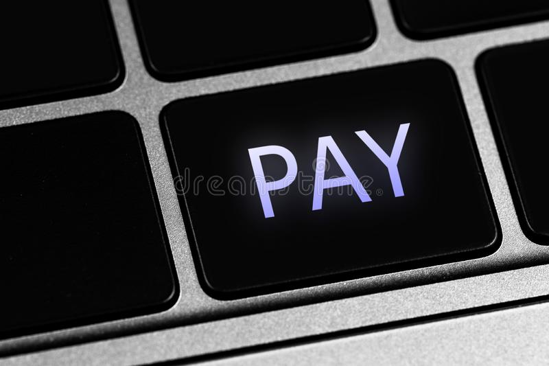 Keyboard and button with text Pay. Closeup keyboard and button with text Pay royalty free stock images