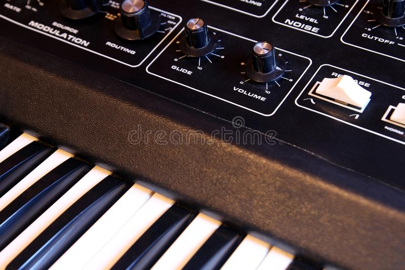 Closeup of keyboard and controls of a retro analogue synthesizer royalty free stock photos