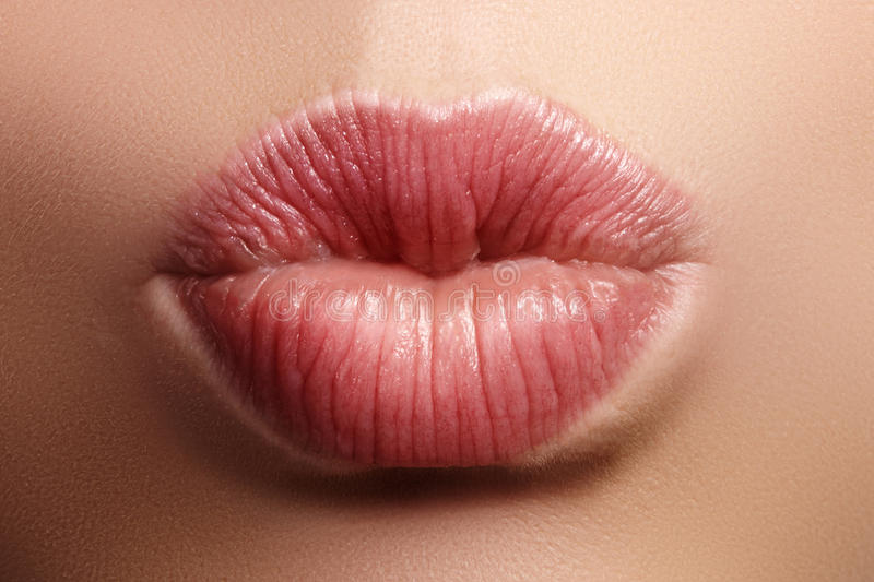 Closeup kiss natural lip makeup. Beautiful plump full lips on female face. Clean skin, fresh make-up. Spa tender lips. Close-up perfect natural lip makeup stock photos