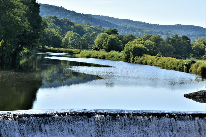Ottauquechee River, Quechee Village, Town of Hartford, Windsor County, Vermont, United States. Closeup of landscape view of Ottauquechee River and dam, in the royalty free stock photos