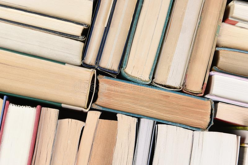Closeup of a large group of used books in random order seen from directly above royalty free stock photos