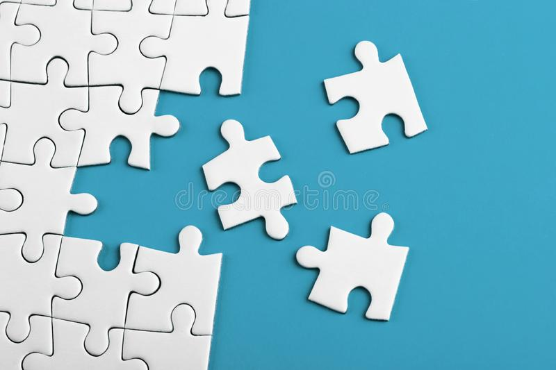 Closeup of the last piece of puzzle missing on blue background stock photo