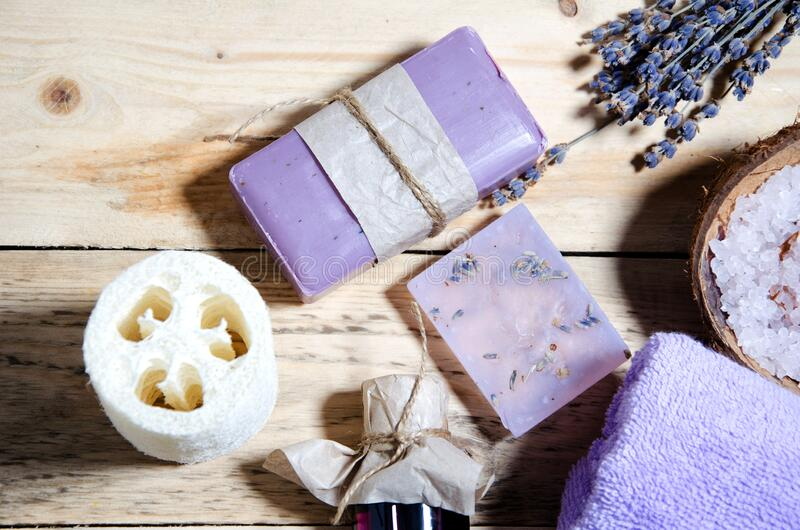 Closeup lavender soap lie on a wooden surface. Body and face care. CPA attributes. Horizontal background royalty free stock images