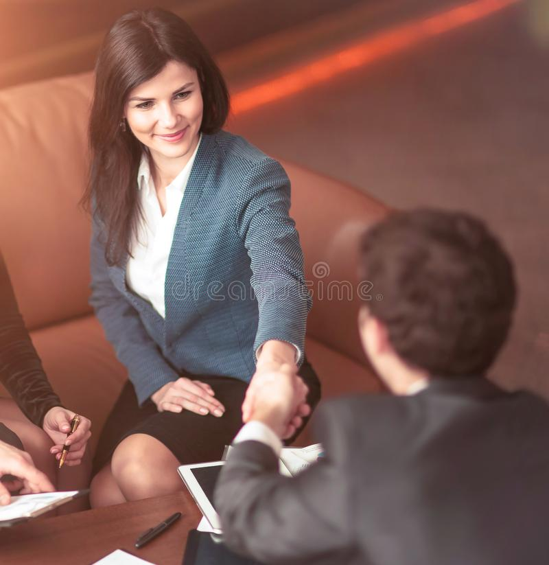 Concept of a reliable partnership - the lawyer and the client, shake hands after signing the financing contract royalty free stock photography
